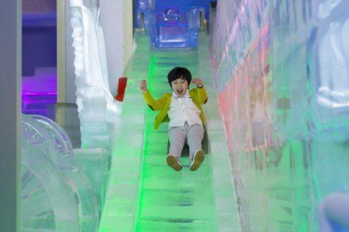 child on ice slide