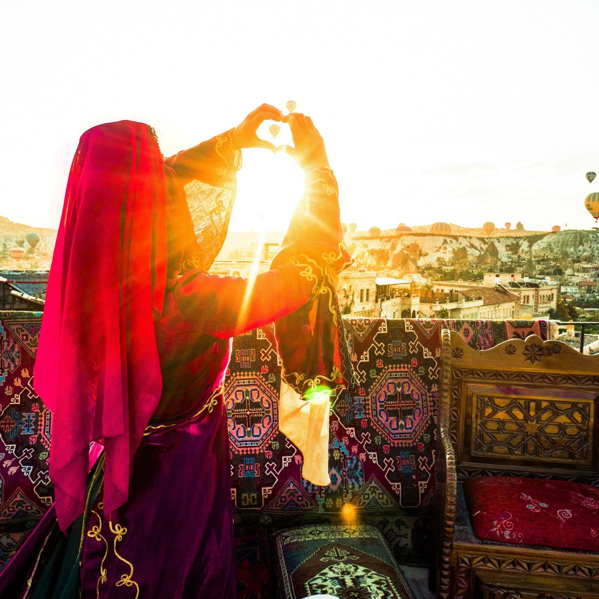 Woman in traditional Turkish dress gazing at the sun