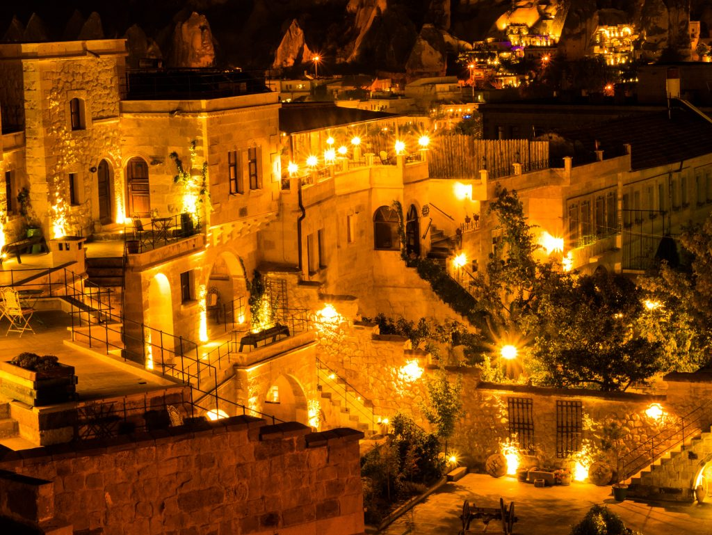cave hotel at night with bright lanterns
