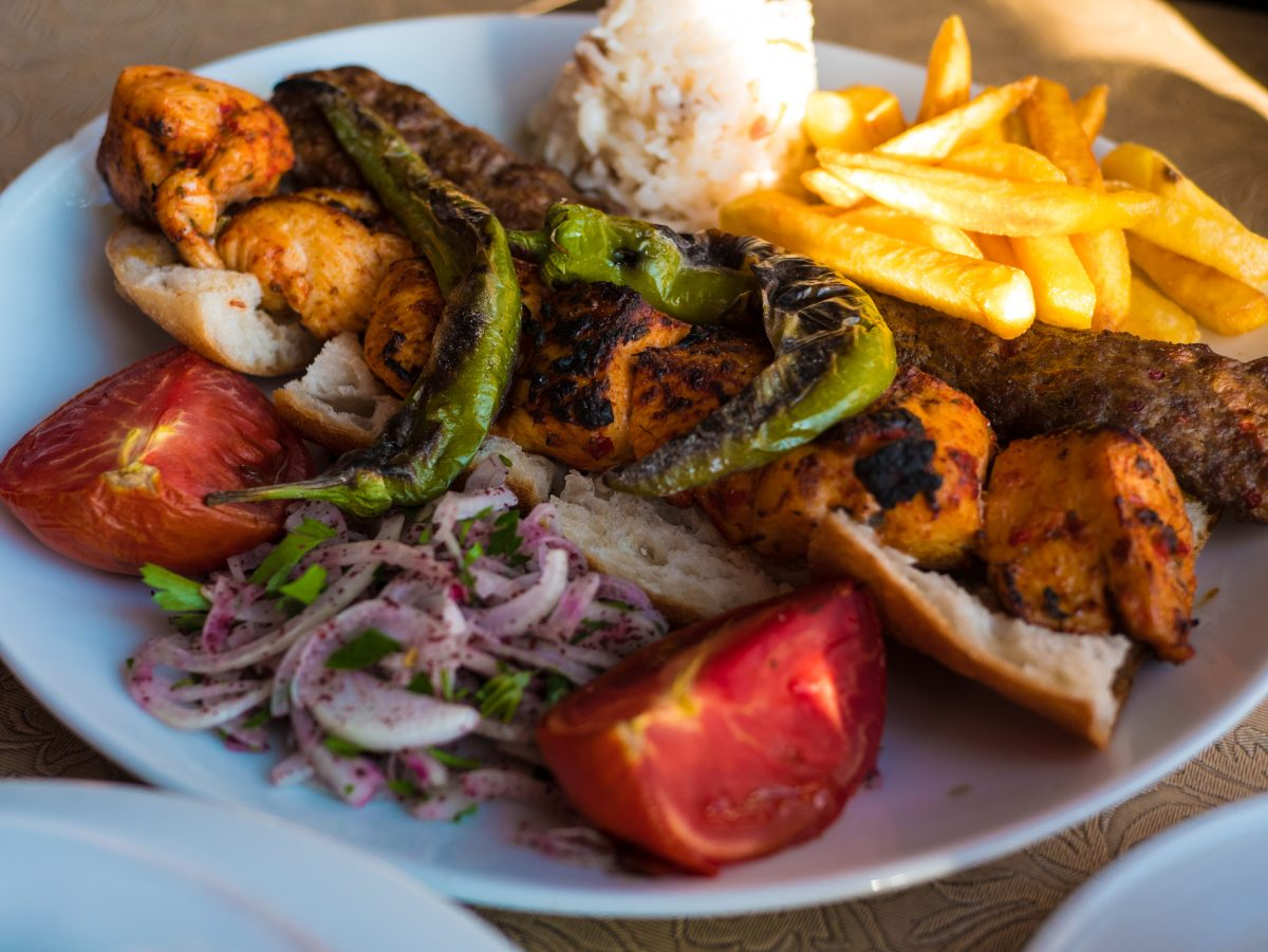 chicken and lamb kebab garnished with green peppers