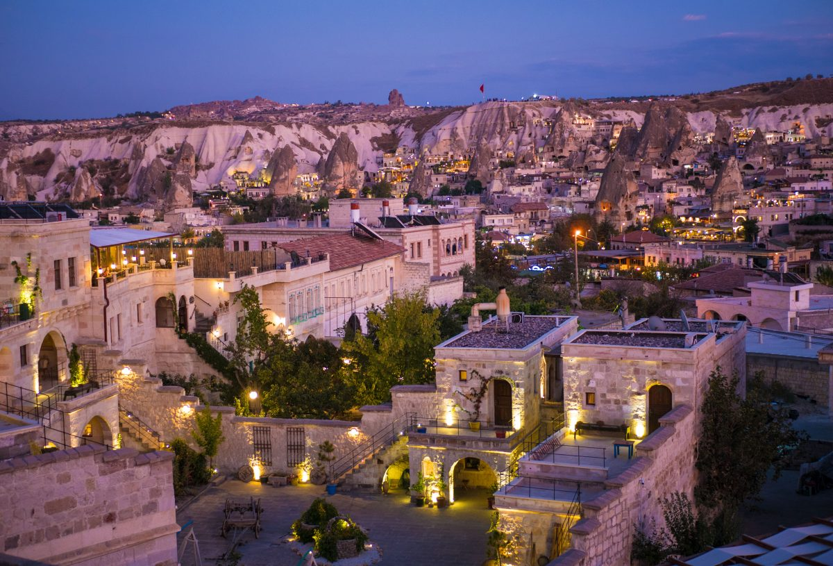 fairy chimneys in the town of goreme at sunset