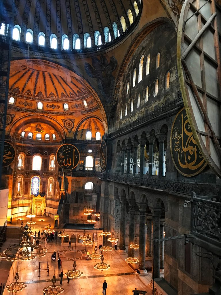 light shines through windows inside the Hagia Sofia church/mosque in Istanbul
