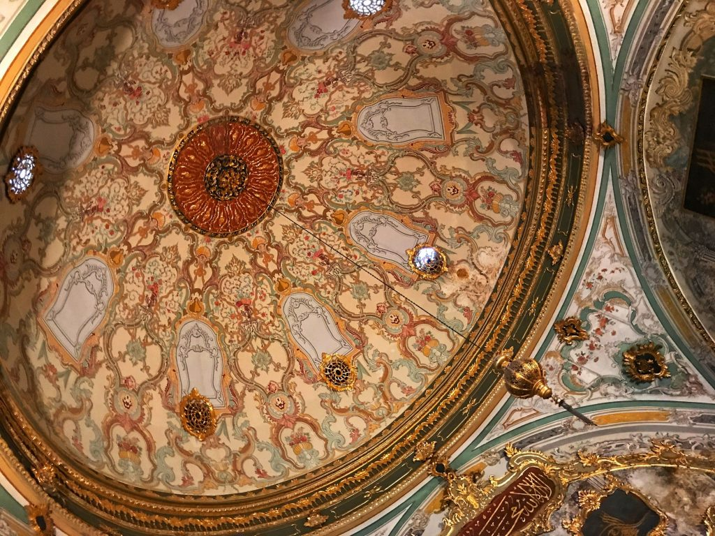 intricately decorated interior of a dome in topkai palace