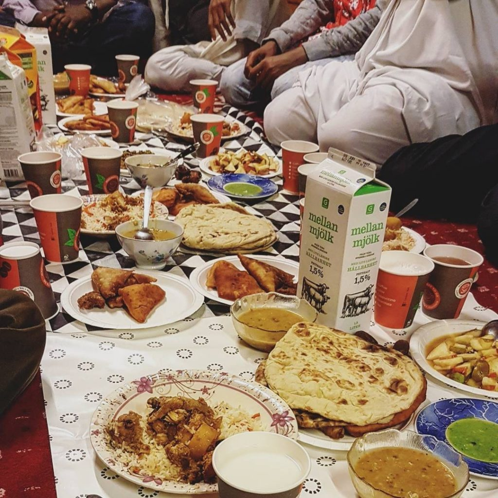 Selection of chappatis, curries, samosas and juices for iftar
