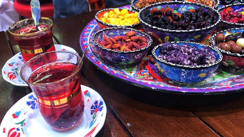 Turkish tea and red, yellow and purple sweets