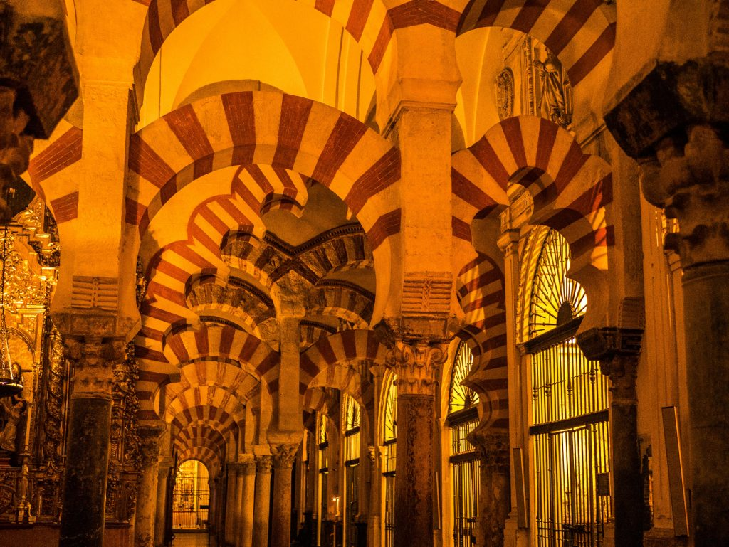 red and white horseshoe arches, black pillars made of marble, in the Mezquita, Cordoba, Andalucia