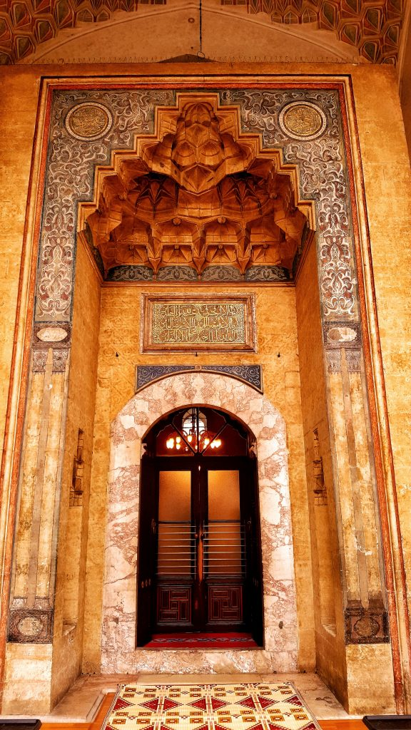 ornate gold coloured door to the gazi huzrev bey mosque in sarajevo