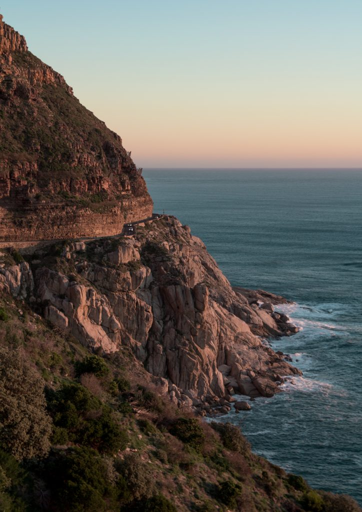 sunset at the cliffs of chapman's peak drive in cape town