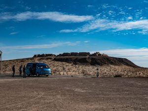 blue minibus in the kyzyl-kum desert, uzbekistan