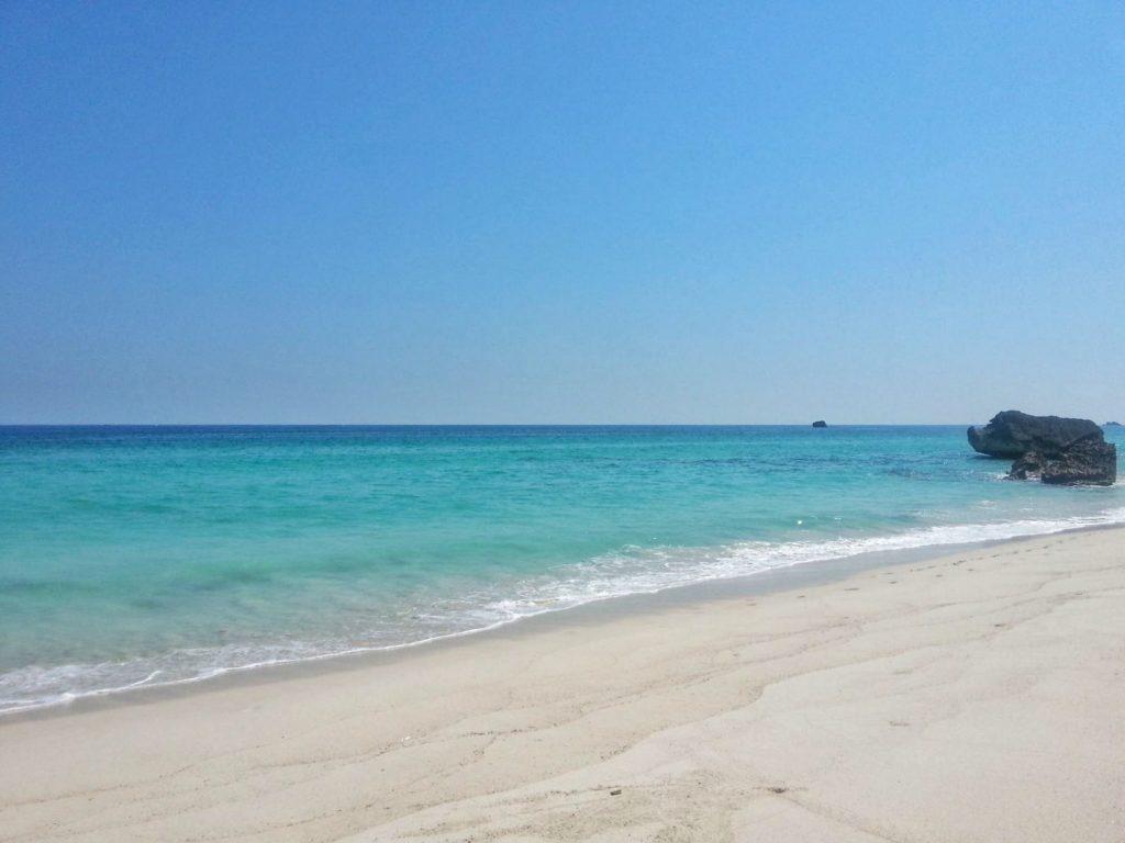 white sandy beach in salalah, oman