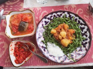 dill noodles, stewed meat and potatoes in Khiva, Uzbekistan