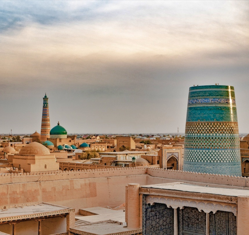 Sunrise over the blue kalta minor tower in khiva