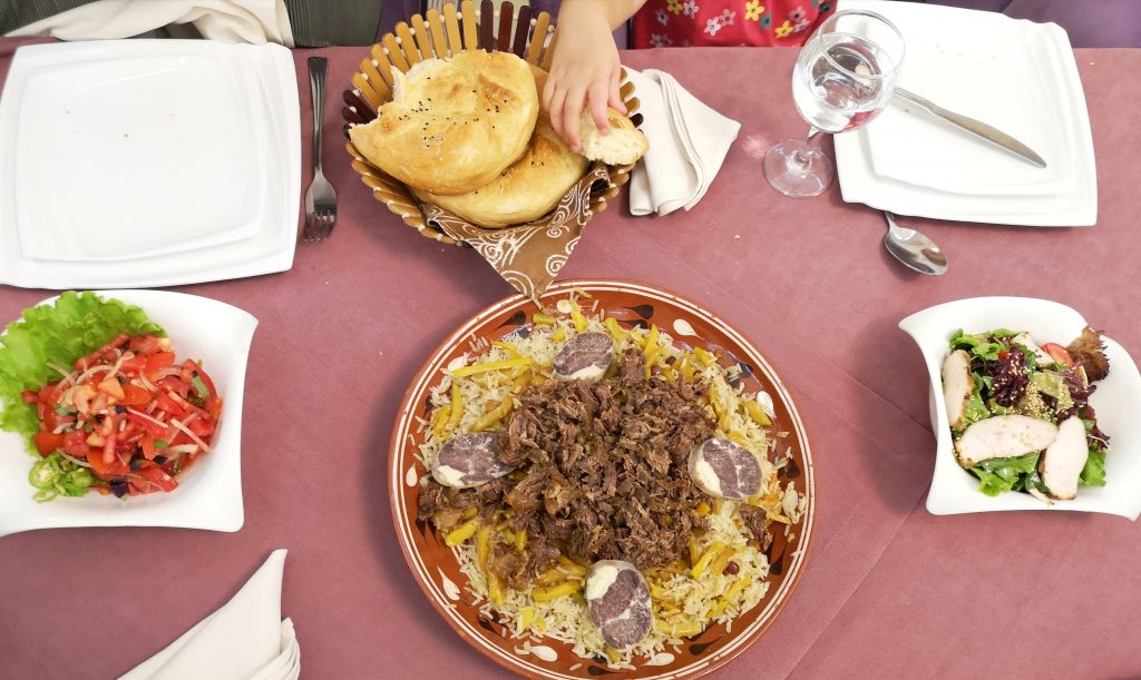 bowl of plov in uzbekistan with horse meat