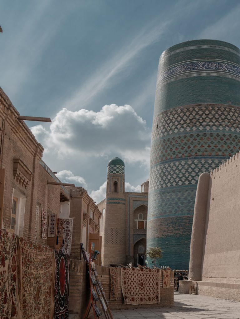 the blue tiled kalta minor against a backdrop of blue sky in khiva.