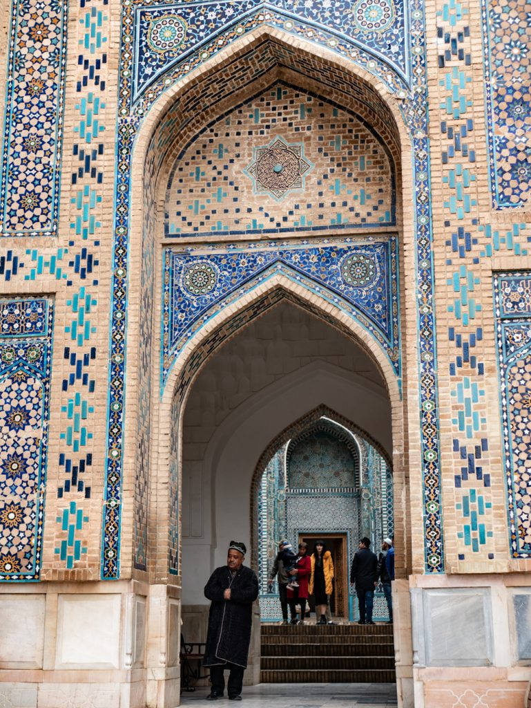 intricately designed archway with blue kufix designs in shah i zinda necropolis