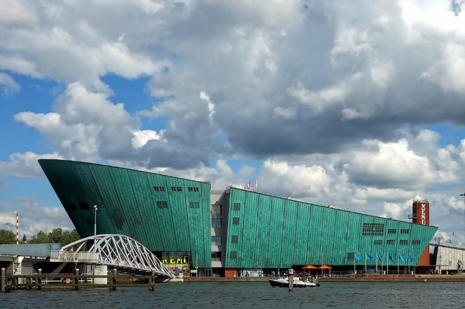 green museum structure in the shape of a boat -nemo science centre