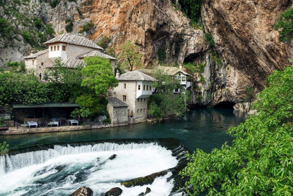 16th century white dervish house nestled against thebakcdrop of cliffs over thebunariver in blagaj, bosnia herzegovina.Bosnia: The Ottoman Legacy
