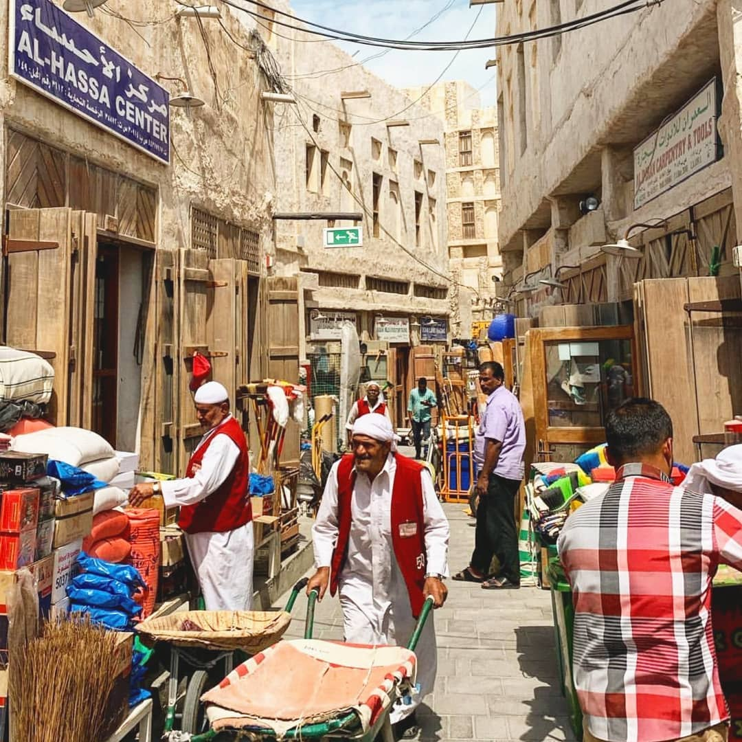 elderly men in the open air market souq waqif in qatar. travel guide to qatar