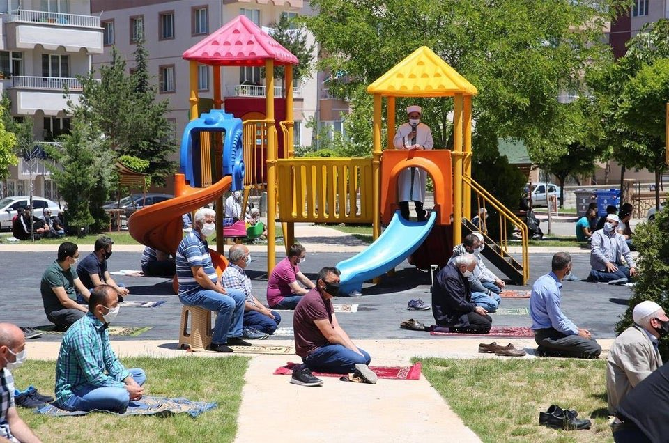 muslims in nevsehir pray jumuah in a children's park mosques reopen under Covid-19 restrictions