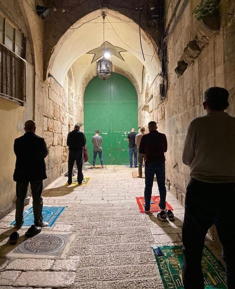 muslims praying by the entrance of masjid al aqsa mosques reopen under Covid-19 restrictions
