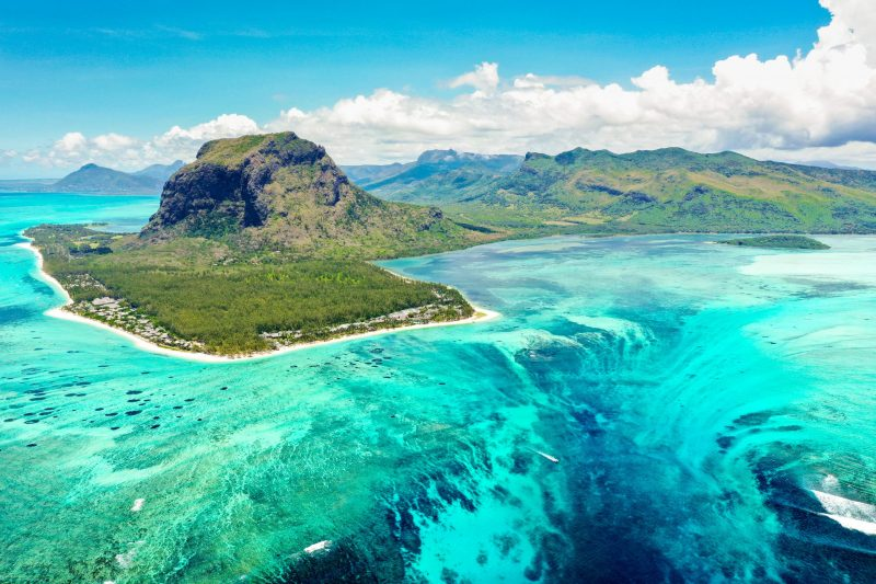 Aerial panoramic view of Mauritius island - Detail of Le Morne Brabant mountain with underwater waterfall perspective optic illusion. Muslim-friendly island